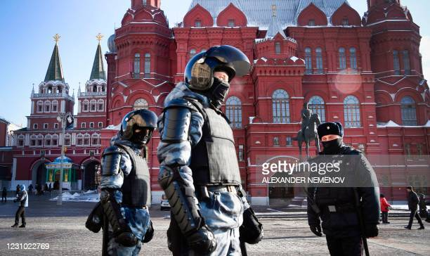 Russian riot police patrol to prevent possible protests in support of jailed opposition leader in downtown Moscow on February 7, 2021. - Alexei...