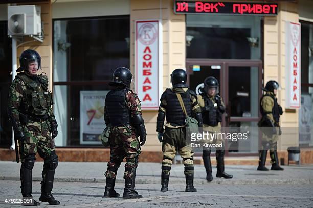 Russian riot police stand in central Simferopol on March 17 2014 in Simferopol Ukraine Voters on the autonomous Ukrainian peninsular of Crimea voted...