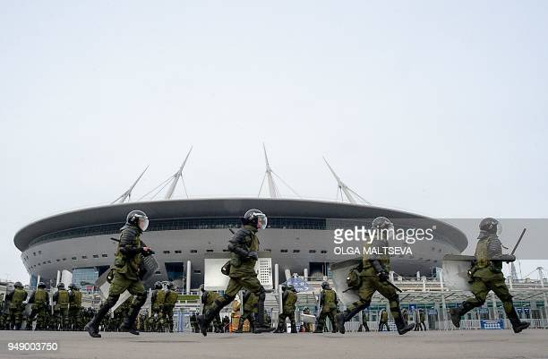 TOPSHOT Russian riot policemen take part in special security exercises at the SaintPetersburg Stadium in Saint Petersburg on April 20 ahead of the...