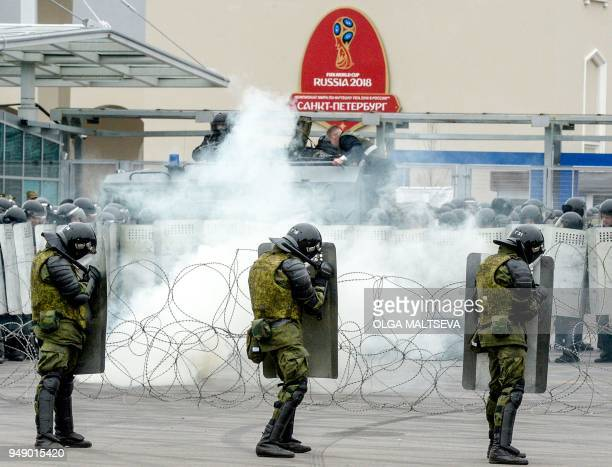 Russian riot policemen take part in special security exercises at the Saint-Petersburg Stadium in Saint Petersburg on April 20 ahead of the 2018 FIFA...
