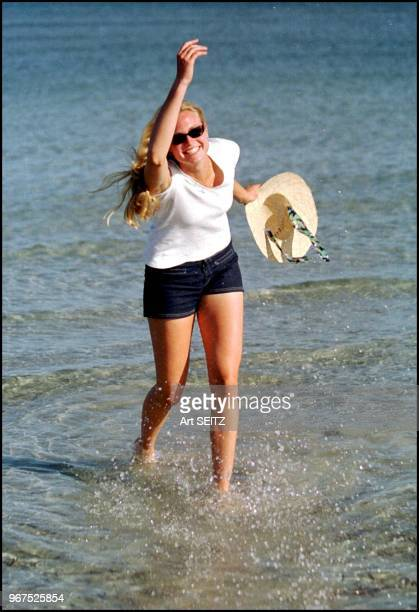 Russian rising tennis star 6'2 Elena Bovina who may have the longest legs in the wta tour playfully splashes part of the Atlantic Ocean towards the...