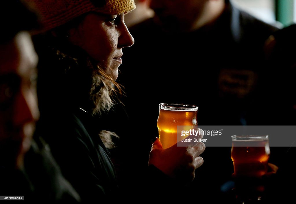 A Russian River Brewing Company customer holds a glass of the newly released Pliny the Younger triple IPA beer on February 7, 2014 in Santa Rosa, California. Hundreds of people lined up hours before the opening of Russian River Brewing Co. to taste the 10th annual release of the wildly popular Pliny the Younger triple IPA beer that will only be available on tap from February 7th through February 20th. Craft beer aficionados rank Pliny the Younger as one of the top beers in the world. The craft beer sector of the beverage industry has grown from being a niche market into a fast growing 12 billion dollar business, as global breweries continue to purchase smaller regional craft breweries such this week's purchase of New York's Blue Point Brewing by AB Inbev.
