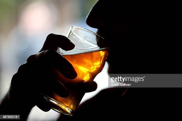 Russian River Brewing Company customer takes a sip of the newly released Pliny the Younger triple IPA beer on February 7 2014 in Santa Rosa...