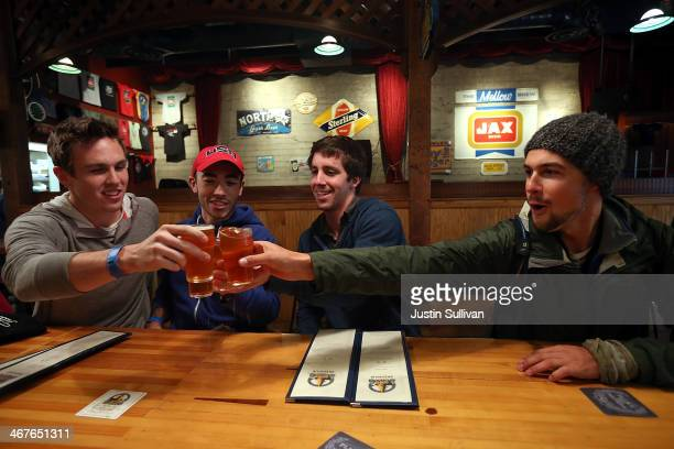 Russian River Brewing Company customers toast their glasses before drinking the newly released Pliny the Younger triple IPA beer on February 7 2014...