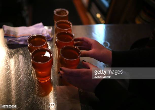Russian River Brewing Company server picks up glasses of the newly released Pliny the Younger triple IPA beer on February 7 2014 in Santa Rosa...