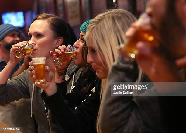 Russian River Brewing Company staff members drink the newly released Pliny the Younger triple IPA beer before opening the doors to the public on...