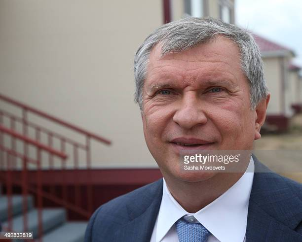 Russian Rosneft oil company President Igor Sechin is seen visiting a newly built village during a one day visit to Amur region to meet for people...