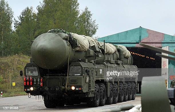 A Russian RS24 Yars thermonuclear intercontinental ballistic missile launcher rolls out of the paint hangar at a strategic missile forces base near...