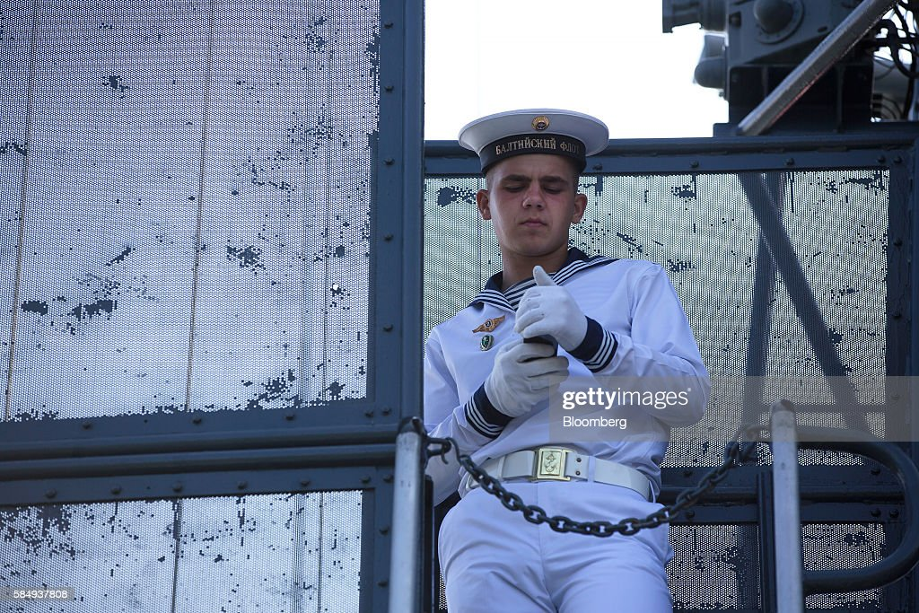 A Russian sailor checks his smartphone aboard the Parchim class corvette Kalmykia MPK 229 warship while supervising visitors during Russian Navy day at the Vistula lagoon in Baltiysk, Russia, on Sunday, July 31, 2016. Amid Russia's recent rearmament, the Kaliningrad region has increasingly returned to its Soviet-era role as a garrison on the strategic Baltic Sea coast. Photographer: Andrey Rudakov/Bloomberg via Getty Images
