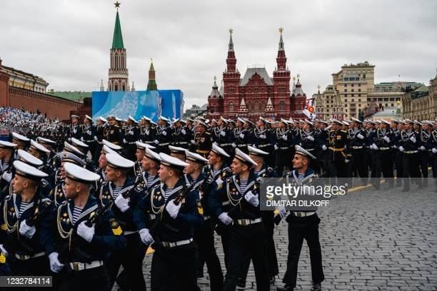 Russian sailors march along Red Square during the Victory Day military parade in Moscow on May 9, 2021. - Russia celebrates the 76th anniversary of...
