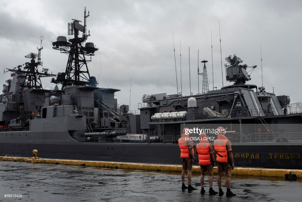 Russian sailors stand by as the Russian Navy large anti-submarine