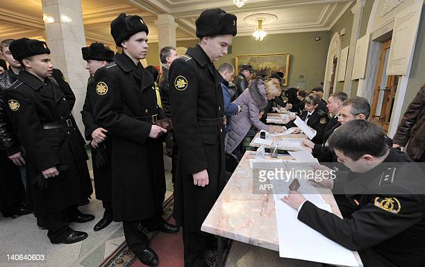 Russian sailors wait in line on March 4, 2012 to obtain a ballot at a polling station in Sevastopol, the military base of the Russian Black Sea Fleet...