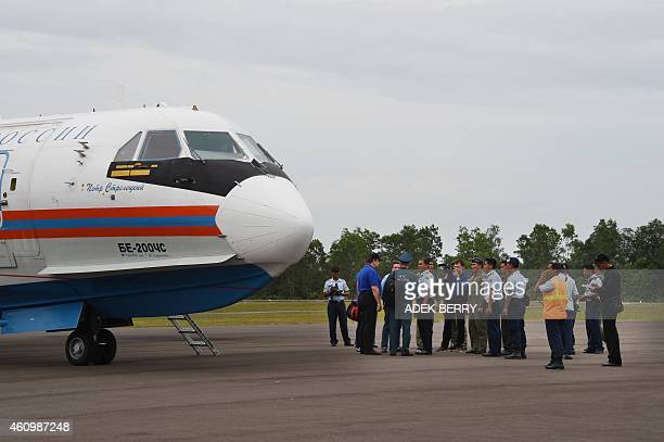 A Russian search and rescue team arrive onboard a Russian BE200 amphibious aircraft in Pangkalan Bun on January 3 to take part in search operations...