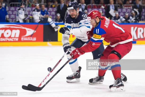 Russian Sergey Andronov and Finland's Joonas Jarvinen vie for the puck during the Ice Hockey World Championship thirdplace match between Finland and...