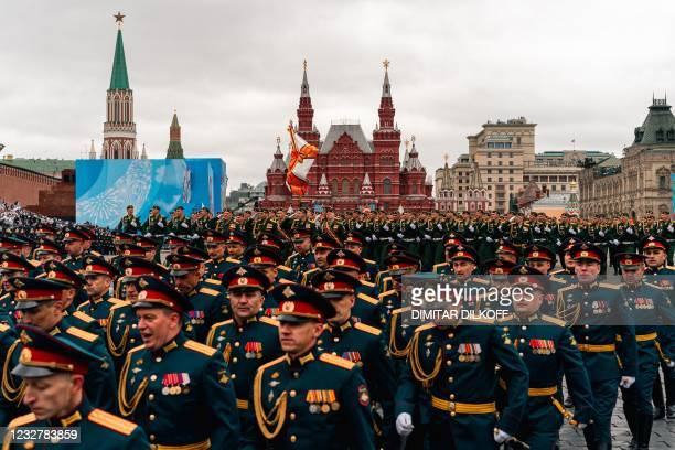 Russian servicemen march along Red Square during the Victory Day military parade in Moscow on May 9, 2021. - Russia celebrates the 76th anniversary...
