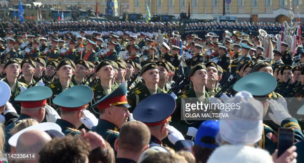 Russian servicemen march on Dvortsovaya Square during the Victory Day military parade in downtown Saint Petersburg on May 9 2019 Russia celebrates...
