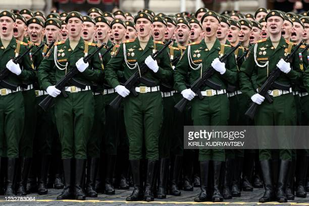 Russian servicemen shout during the Victory Day military parade at Red Square in Moscow on May 9, 2021. - Russia celebrates the 76th anniversary of...