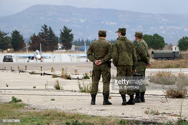 Russian servicemen stand at the Russian Hmeimim military base in Latakia province in the northwest of Syria on December 16 2015 Russia began its air...