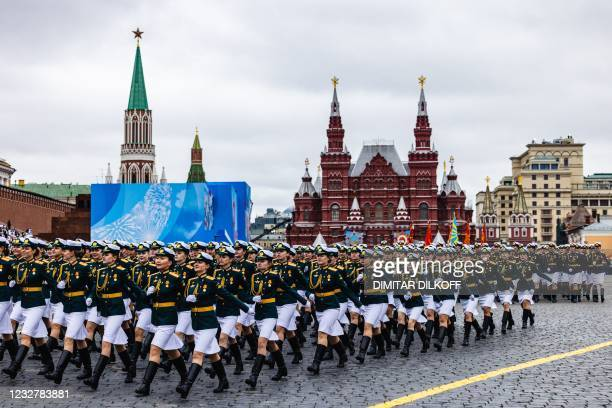 Russian servicewomen march along Red Square during the Victory Day military parade in Moscow on May 9, 2021. - Russia celebrates the 76th anniversary...