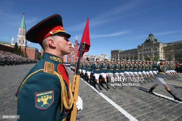 TOPSHOT Russian servicewomen march at Red Square during the Victory Day military parade in Moscow on May 9 2018 Russia marks the 73rd anniversary of...