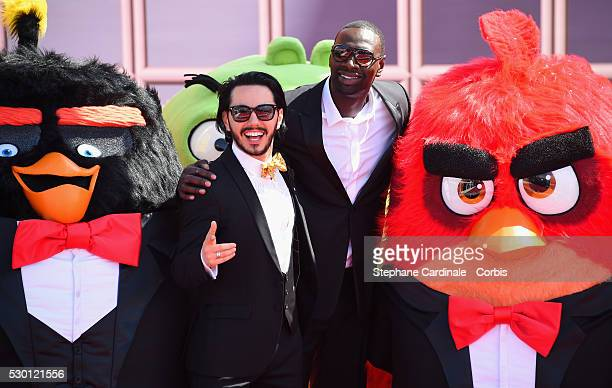 Russian singer Timur Rodriguez and French actor Omar Sy attend The Angry Birds Movie Photocall during the annual 69th Cannes Film Festival at JW...
