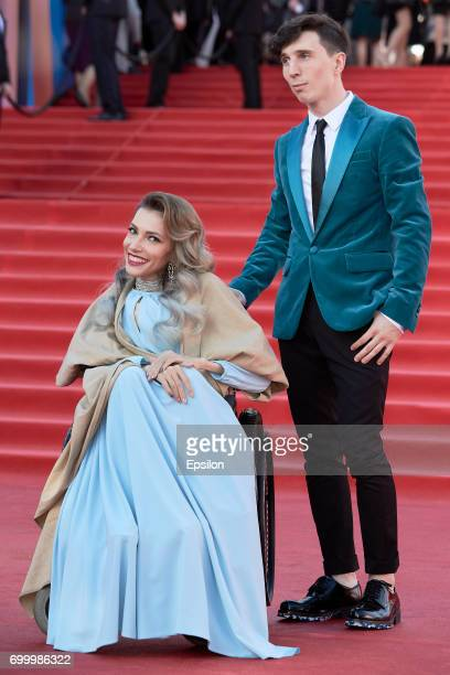 Russian singer Yulia Samoylova and her husband musician Alexey Taran attend opening of the 39th Moscow International Film Festival outside the Karo...