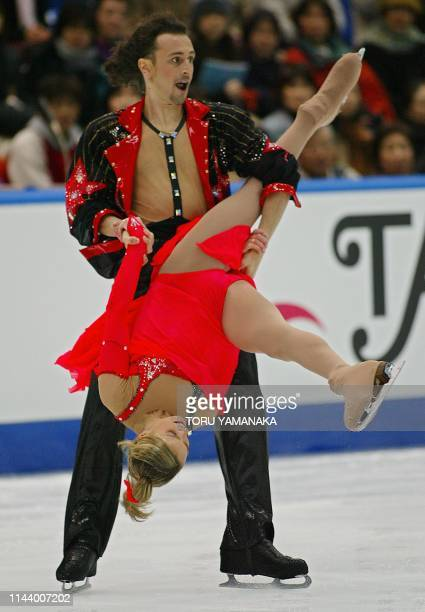 Russian skater Ilia Averbukh holds his partner Irina Lobacheva during free dance in the ice dancing event in the NHK Trophy figure skating...