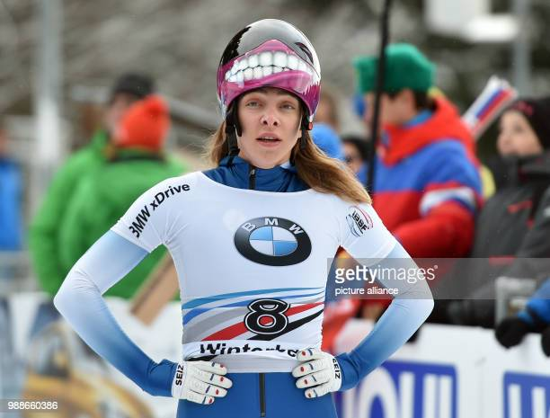 Russian skeleton pilot Elena Nikitina comes in third after the second run of the women's singles at the Skeleton World Cup in Winterberg, Germany, 8...