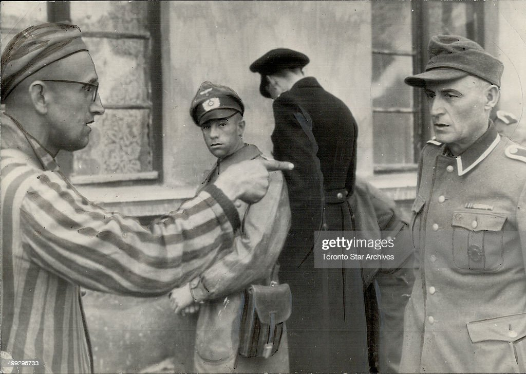 Russian slave laborer here points out a former German guard; right; who beat prisoners in the Nazi c... : News Photo