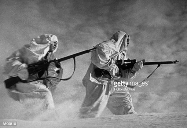 Russian snipers fighting on the Leningrad front during a blizzard. Original Publication: Picture Post - Snipers on Lenigrad Front - pub. 1943