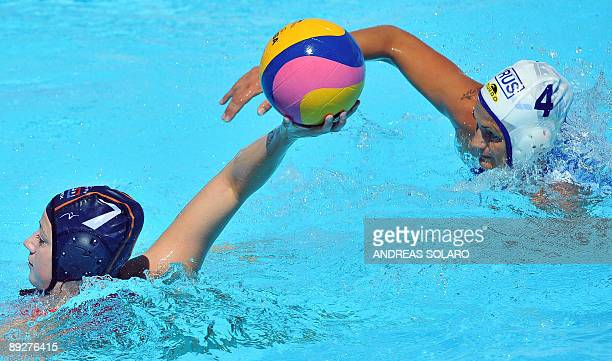 Russian Sofya Konukh fights for the ball with Iefke Van Belkum of Netherlands during the waterpolo Quarterfinal Women on July 27 2009 at the FINA...