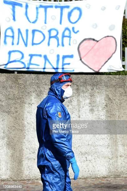 Russian soldier attends to sanitize the Carlo Giovanni Rota retirement home for the elderly in Almenno San Salvatore on April 2, 2020 in Bergamo,...