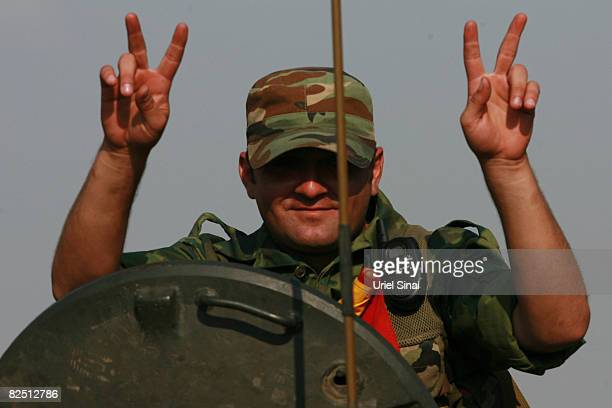 Russian soldier flashes victory signs as he rides an APC August 22 2008 near Igoeti on the road from Tbilisi to Gori Georgia Russia is working to a...