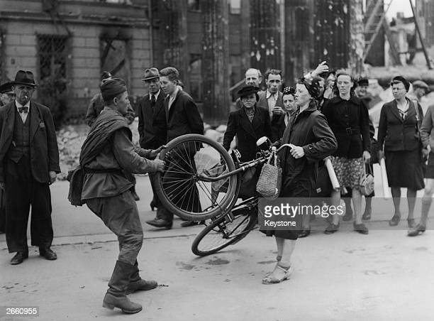 Russian soldier involved in a misunderstanding with a German woman in Berlin, over a bicycle he wished to buy from her.