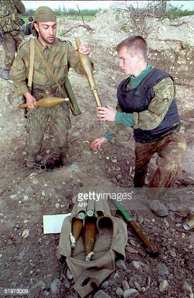 Russian soldier is armed with grenades before going into battle near the Chechen rebel stronghold of Bamut 25 April The Russian defense ministry...