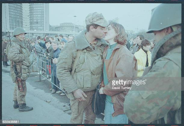 Russian Soldier Kissing His Wife