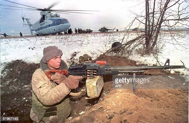 Russian soldier mans a machine gun at a landing zone's defensive perimeter near Khasavurt on the border between Chechnya and Dagestan 14 December The...