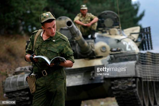 A Russian soldier reads a magazine at a Russian Army position August 15 2008 at the entrance to the town of Gori Georgia Tensions continued in the...