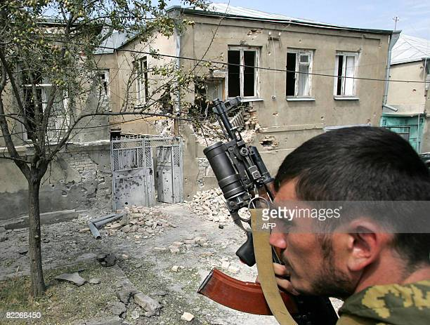 A Russian soldier rides an APC through the South Ossetian town of Tskhinvali on August 11 2008 Britain's Europe Minister Jim Murphy said Russia's...