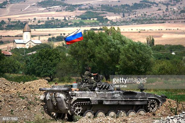 Russian soldier sits on a armoured personal carrier as Russian troops take positions on August 16 2008 near the village of Igoeti on the road from...