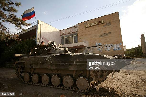 Russian soldier sits on top of an armoured personal carriere at a Russian army position on August 16 2008 in the village of Igoeti on the road from...