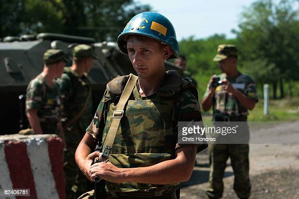 Russian soldier stands guard at the border of Georgia and the sepratist province of Abkhazia August 18 2008 near Zugdidi Georgia Russian forces have...