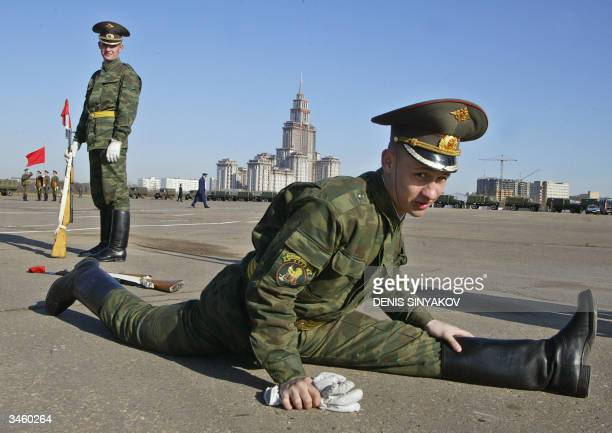 Russian soldier warms up prior the Victory Day parade exercise in Moscow 23 April 2004 Russia will mark the 59th anniversary of the victory over Nazi...