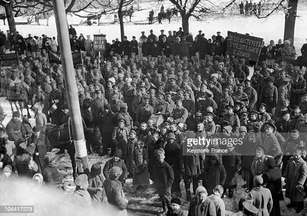 Russian soldiers and children listening to an orator sent by the provisional government headed by KERENSKI after the Revolution of February 1917
