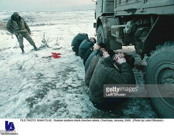 N364773 02 Russian soldiers check chechen rebels Chechnya January 2000
