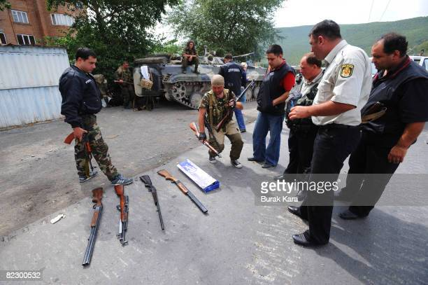 Russian soldiers display weapons collected from local residents on the streets of Gori August 14 2008 in Gori near South Ossetia Georgia Tensions...