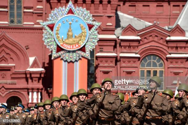 Russian soldiers dressed in historical uniforms march as they take part in a rehearsal for the Victory Day military parade on Moscow's Red Square on...