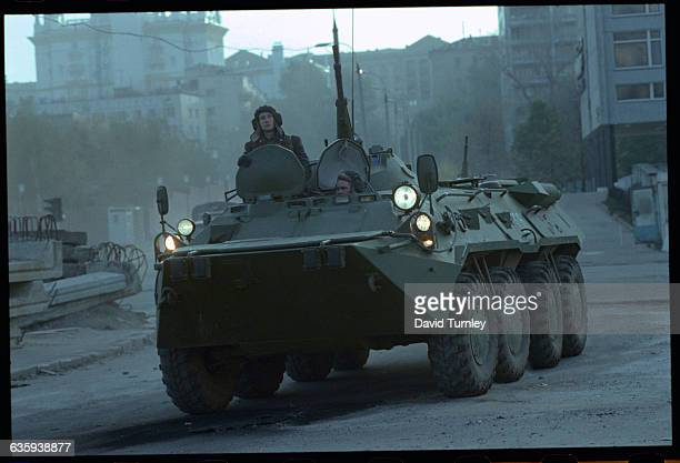 Russian Soldiers driving down a Deserted Street