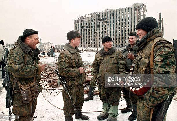 Russian soldiers joke in February 1996 in front of the destroyed presidential palace in Grozny capital of the breakaway southern republic of Chechnya...