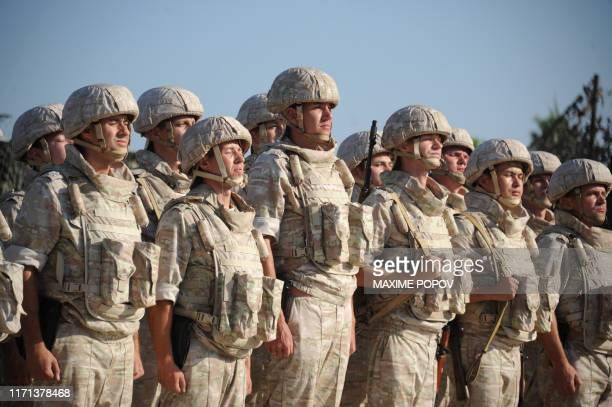 Russian soldiers line up in front of their commander at the Russian military base of Hmeimim located southeast of the city of Latakia in Hmeimim...